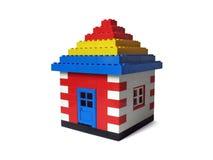 Het huis van het stuk speelgoed dat op wit wordt geïsoleerd Royalty-vrije Stock Afbeeldingen