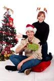 Het huis van Kerstmis van het paar stock foto