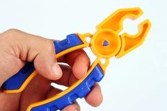 Het hulpmiddel van de hand en stuk speelgoed Royalty-vrije Stock Afbeelding