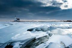 Het ijs en de vuurtoren van de plank Stock Afbeelding