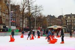 Het ijs van Amsterdam het schaatsen stock afbeeldingen