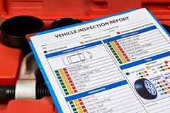 Het inspectierapport van het voertuigvoertuig stock foto's