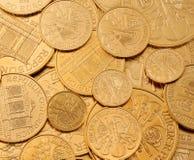 Het investeren in echt goud dan gouden passement en goud Stock Foto's