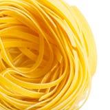 Het Italiaanse geïsoleerde close-up van macaronitagliatelle nest Royalty-vrije Stock Afbeeldingen