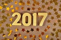 het jaar gouden cijfers van 2017 en gouden sterren Stock Fotografie