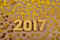 het jaar gouden cijfers van 2017 en gouden sterren Stock Foto