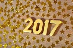 het jaar gouden cijfers van 2017 en gouden sterren Royalty-vrije Stock Fotografie