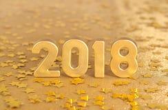het jaar gouden cijfers van 2018 en gouden sterren Stock Foto