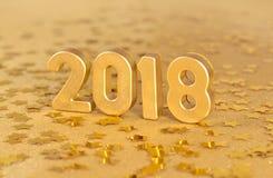 het jaar gouden cijfers van 2018 en gouden sterren Stock Afbeeldingen