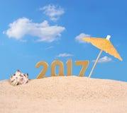 het jaar gouden cijfers van 2017 met zeeschelp Royalty-vrije Stock Foto's