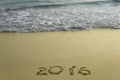 het jaar van 2015 en van 2016 op het zandstrand Stock Foto