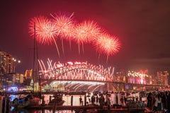 Het jaar van het vuurwerkeve new van Sydney toont bij Havenbrug van Clak-park Sydney Australia Royalty-vrije Stock Foto's