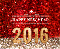 het jaar van 2016 in rood en het goud schitteren achtergrond, Vakantieconcept DE Royalty-vrije Stock Afbeelding
