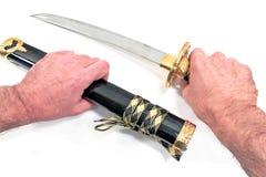 Het Japanse geïsoleerde zwaard van samoeraienkatana Stock Foto's