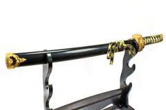 Het Japanse zwaard van samoeraienkatana op tribune Royalty-vrije Stock Afbeeldingen