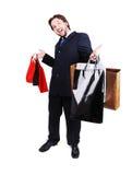 Het jonge aantrekkelijke mens dragen passen en het houden van winkel aan Royalty-vrije Stock Foto's