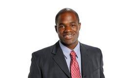 Het jonge Afrikaanse Amerikaanse glimlachen van de Zakenman stock foto