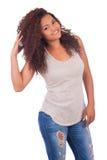 Het jonge Afrikaanse Glimlachen van de Vrouw Stock Afbeeldingen