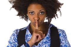 Jonge afro Amerikaan die shhh zeggen Royalty-vrije Stock Afbeeldingen