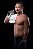 Het jonge atleet stellen met naakt torso Stock Foto