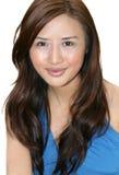Het jonge Aziatische Glimlachen van de Vrouw Stock Fotografie