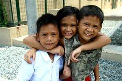 Het jonge Aziatische kinderen glimlachen royalty-vrije stock afbeeldingen