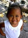 Het jonge Aziatische meisje glimlachen Stock Afbeeldingen