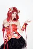 Het jonge Aziatische meisje kleedde zich in cosplay kostuum Stock Foto's