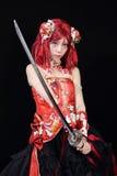 Het jonge Aziatische meisje kleedde zich in cosplay kostuum Stock Foto