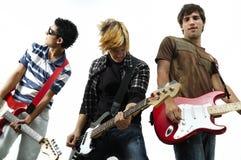 Het jonge band stellen met geïsoleerda instrument, Stock Foto