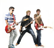 Het jonge band stellen met geïsoleerdeS instrumenten, stock fotografie