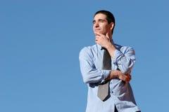 Het jonge bedrijfsmens denken royalty-vrije stock afbeeldingen