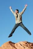 Het jonge bedrijfsmens springen Stock Foto's