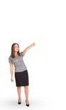 Het jonge dame gesturing met exemplaarruimte stock afbeelding