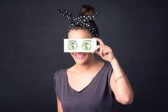Het jonge document van de meisjesholding met groen dollarteken Stock Foto's