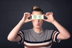 Het jonge document van de meisjesholding met groen dollarteken Royalty-vrije Stock Afbeeldingen