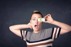 Het jonge document van de meisjesholding met groen dollarteken Royalty-vrije Stock Fotografie