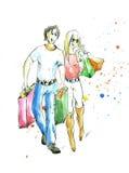 Het jonge echtpaar is het bezette shoping Stock Foto's