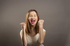 Het jonge gebaar van de vrouwenwinnaar Stock Foto