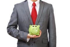 Het jonge Geld van de Besparing van de Zakenman Stock Foto