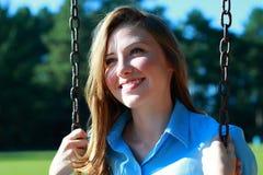 Het jonge Glimlachen van de Vrouw Royalty-vrije Stock Afbeeldingen