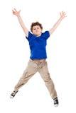 Het jonge jongen springen Stock Foto