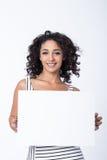 Het jonge lege teken van de bedrijfsvrouwenholding stock fotografie
