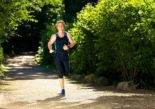 Het jonge Lopen van de Atleet Stock Foto