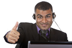Het jonge mannelijke uitdrukkelijke geluk van de call centreagent Royalty-vrije Stock Foto's