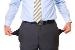 Het jonge mannetje toont lege geïsoleerdes zakken, Royalty-vrije Stock Afbeeldingen