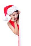 Het jonge meisje dat van Kerstmis leeg aanplakbord toont Stock Fotografie