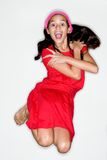 Het jonge meisje doet een sprong van vreugde Royalty-vrije Stock Afbeeldingen