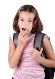 Het jonge meisje eet chocolade stock fotografie