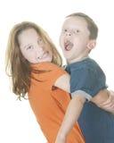 Het jonge meisje en jongens spelen stock afbeelding